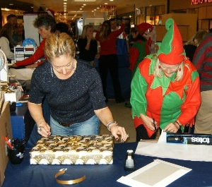 Logo for UCP Holiday Gift Wrap Booth Volunteers Needed