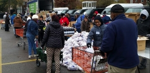 Volunteers passing out food at our mobile pantry.