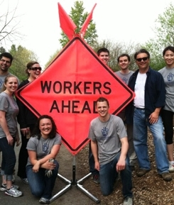 Mercer employee volunteers clean up a trail in Seattle.