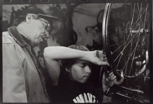 Father and son wrenching on bikes