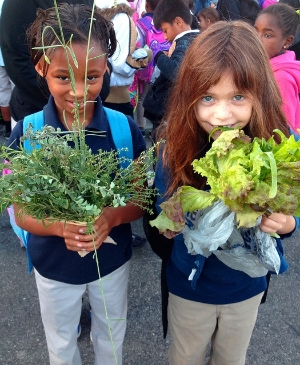 Students WIth Garden-Grown Vegetables