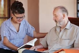 Woman volunteer supporting male patient
