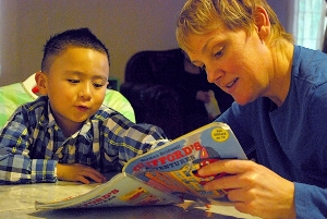 Tutor Reading with child
