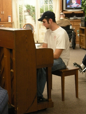 Volunteer Playing Piano at Country Manor!