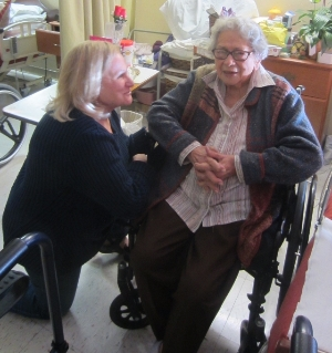 Volunteer delivering flowers to a resident