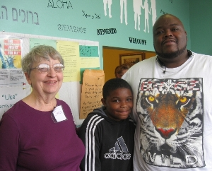 Willie, his dad, and his reading coach, Ms. Sarah!