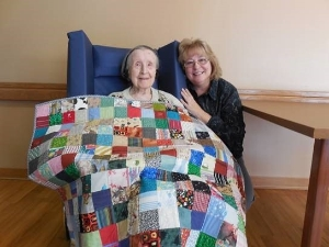 Allay Volunteer & Client with quilt
