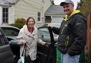 Volunteer driver with grateful customer