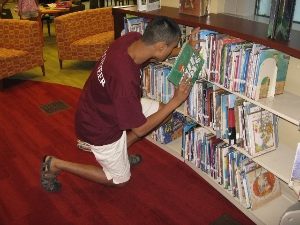 Crowell Public Library Volunteer hard at work!